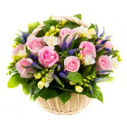 Basket with pink roses and freesias, white scented