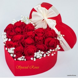 Heart box of red roses ..