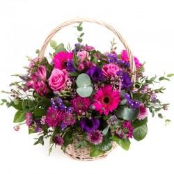 Cesto di fiori dai colori  rosa fuxia ...