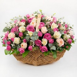 Basket with two dozen pink roses in a beautiful wicker basket.