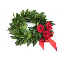 Wreath of laurel leaves with berries and red roses.