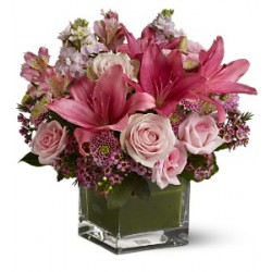 The composition and the glass-rose-alstroemeria-lilies rose..