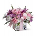 Romantic Composition in glass with flowers with delicate tones.