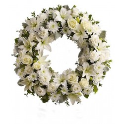 Funeral wreath of roses and white lilies