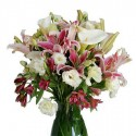 Beam lilium pink and white callas in green leaves.