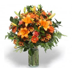 Beam lilium gerbera daisies by the tone of orange in the green leaves