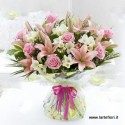 A dozen roses and lilies in pink tones clear