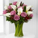 Bouquet of white callas and roses lavender