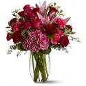 Combination of 12 red roses, lilies pink,pink carnations flowers furniture and green complementary