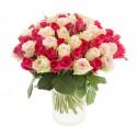 Two dozen cream roses and pink fuchsia